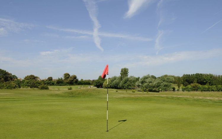 WBGC - 15TH HOLE - GREEN WITH RED FLAG AND VIEW TO 13TH HOLE 2