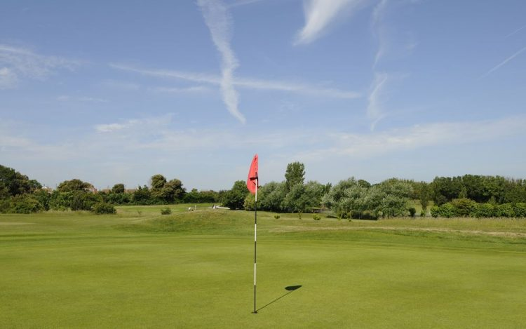 WBGC - 15TH HOLE - GREEN WITH RED FLAG AND VIEW TO 13TH HOLE