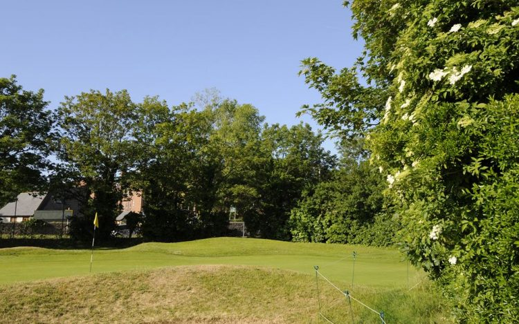 WBGC - 17TH HOLE - BUNKER AND GREEN WITH FLOWERS 2