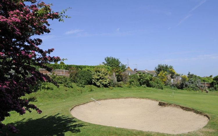 WBGC - 5TH HOLE - VIEW OVER BUNKER AND GREEN WITH FLOWERS FRONT 2
